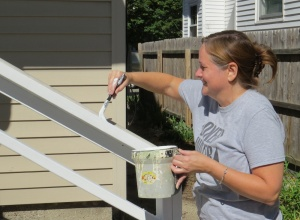 Painting the railing at My House Ministry